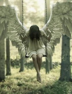 It was the white angel. She just sat there, always on her swing swaying back and forth.