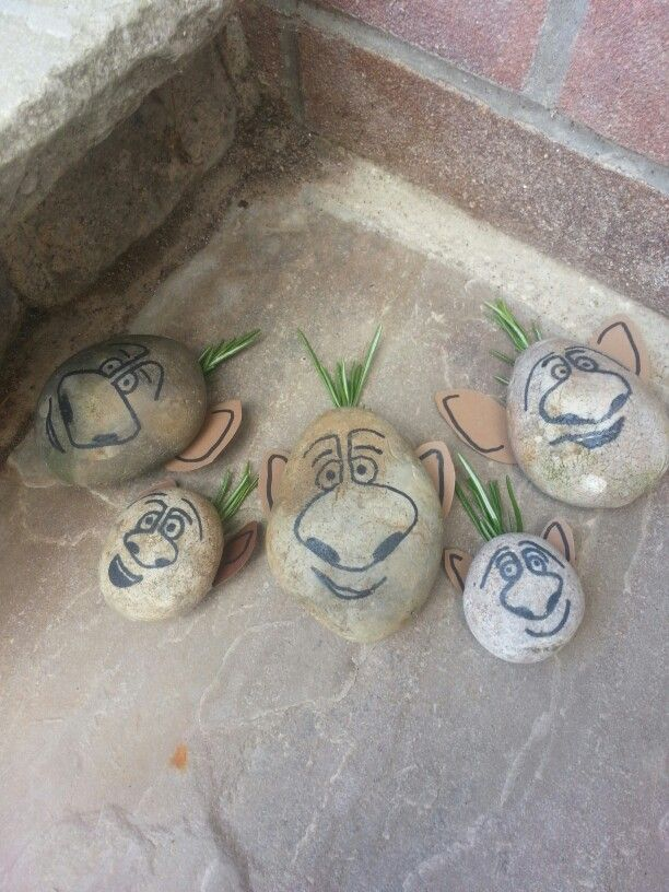 DIY rock trolls from Frozen. Great to hide in the garden for parties! Stick some rosemary for hair and brown ears on the back with tape.