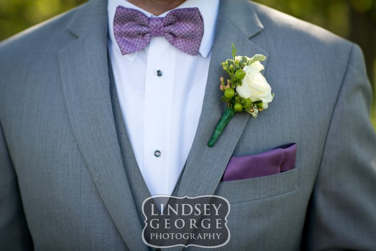 Groom with grey tux purple bowtie and mini white rose boutonnière click to view full gallery small town wedding Arlington Nebraska