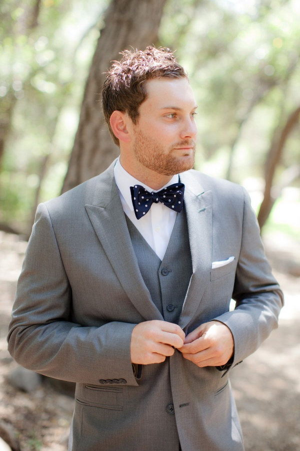 groom in polka dots