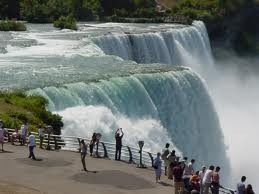 NIAGARA FALLS - is the collective name for three waterfalls that straddle the international border between the Canadian province of Ontario and the U.S. state of New York. They form the southern end of the Niagara Gorge.