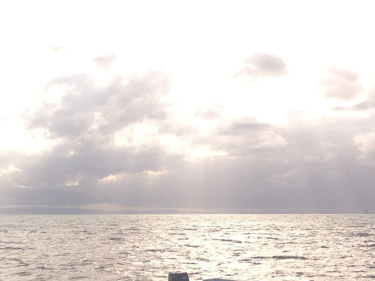 The sun emerging from behind the clouds #moretonbay #moretonisland