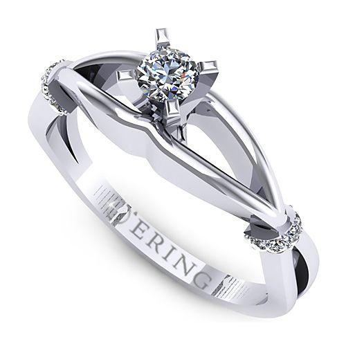 Inelul este realizat din aur alb 14k, greutate: ~2.50gr.                                    Produsul are in componenta sa: 10 x diamant, dimensiune: ~1.10mm, greutate totala: ~0.06ct, forma: round 1 x diamant, dimensiune: ~3.20mm, greutate: 0.12ct , culoare: G, claritate: VS2