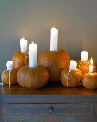 Neat idea for pumpkin decorating. I would just add a little fall leaf garland to complete the look.
