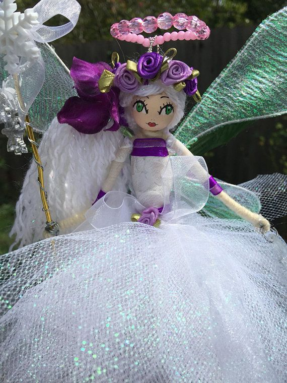 Handcrafted flower fairy doll I made and painted the face manually.. perfect for all occasion Handmade with lots of love... Perfect gift for a birthday... Bridesmaid gift... Christening... Giveaway... A little something just to say thank you... Or just to treat yourself:) New Flower Fairy Doll designs are being handcrafted every day. I have lots of designs available so that you can find a Flower Fairy Doll that is uniquely your own. So please check my other listings. This is truly a la...