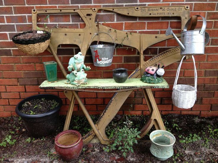 One if a kind gardening table, made from the harp out of a 1909 upright grand piano!