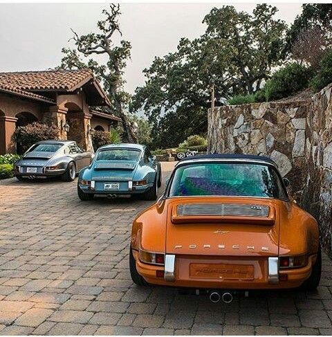 Porsches all lined up.