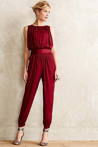 Shop this look for $61:  http://lookastic.com/women/looks/gold-earrings-grey-leather-heeled-sandals-burgundy-jumpsuit/5573  — Gold Statement Earrings  — Grey Leather Heeled Sandals  — Burgundy Jumpsuit