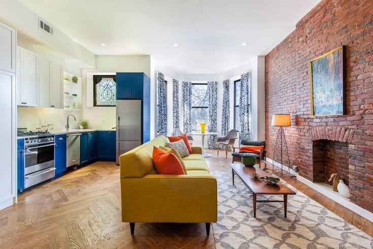 deco jaune curry mur brique exposee interieur plan ouvert #interiordesign