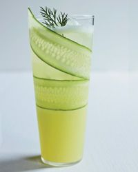 Cucumber-Lemonade Mocktail 1 paper-thin, lengthwise slice of European cucumber, for garnish Ice 1/4 teaspoon finely chopped dill, plus 1 dill sprig, for garnish 1 tablespoon agave syrup 1 tablespoon fresh lemon juice 1 tablespoon fresh lime juice 1/4 cup fresh cucumber juice (see Note) 1/4 cup chilled club soda