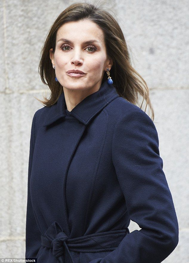 Queen Letizia of Spain stepped out in a chic collarless coat, bootleg trousers and a leath...