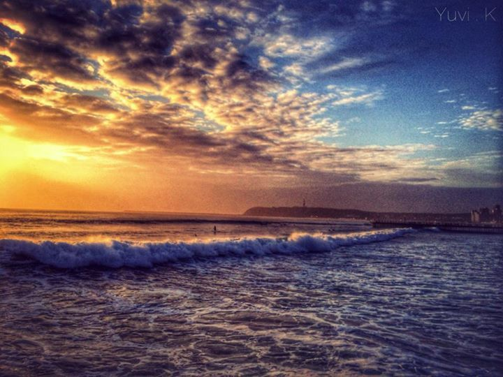 Sunrise over Durban's beaches with the bluff in the beackground