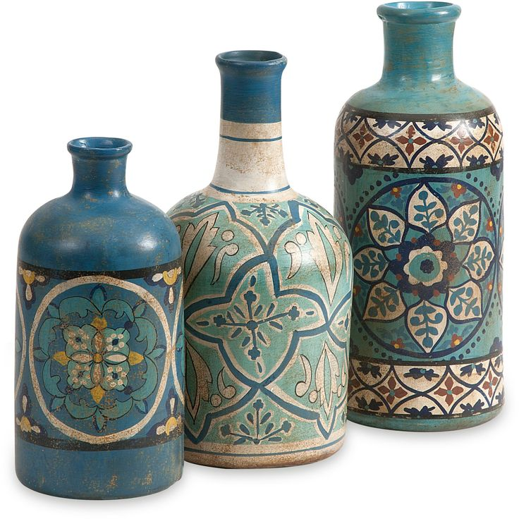 This set of hand painted bottles feature beautiful jewel toned patterns and are a globally inspired set of eclectic terracotta accents for any space.