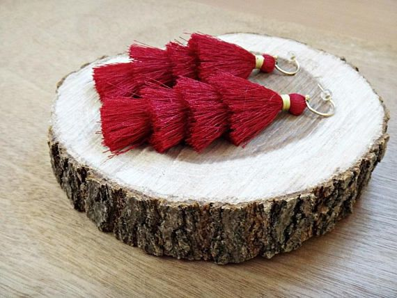 Red Regina Earrings  Handmade earrings made of red artificial silk tassels and gold plated brass hoops. We like how they swish playfully as you walk. Show them off with an updo or smooth tresses.   Total length from top of earring hoop to bottom is 4.13 / 10.5 cm.   Our Items are handmade