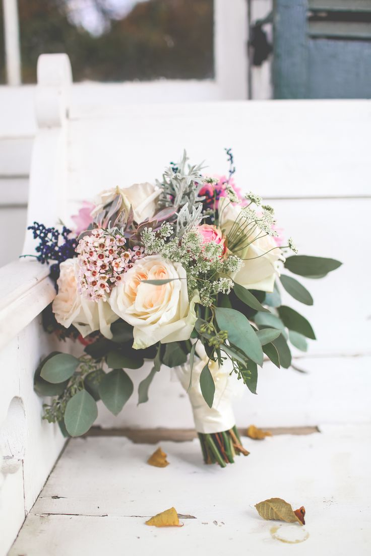My Navy Blue and Blush Pink bouquet with pink dahlias, cream colored cabbage roses, pink wax flower, Queen Annes lace, dusty miller, seeded eucalyptus and succulents created by Bella Fleur in Altamont, NY for our vintage fall wedding at The Appel Inn in Altamont, NY. Photographed by Keira Lemonis Photography.