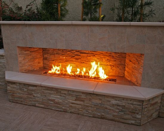 Entrancing Modern Outdoor Fireplace Designs: Entrancing Contemporary Patio With Marvelous Modern Outdoor Gas Fireplace Designs With Stone Wall Accents Also Wide Tile Floor And Tile Wall ~ wangluopr.com Exterior Design Inspiration