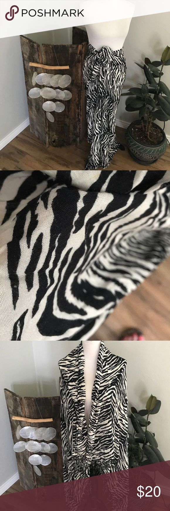 Zebra print swim cover/large scarf I got this on a trip to Mexico and have just not used it very much. As shown in the photos, it can be worn many different ways, both as a skirt, swimsuit cover, scarf. I am sure there are so much more ways to style than what I've shown. Has fringe on both ends. 59x43. I'm not sure of the material but it is very soft. There are a couple small runs or snags, but with how small they are and the zebra stripe you can hardly see them. Accessories Scarves & Wraps