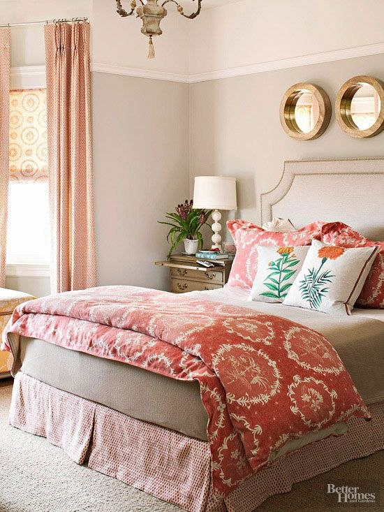 Select the largest pattern first to serve as a jumping-off point for other patterns, colors, and accessories. Here, a coral duvet and shams in a floral medallion pattern, informed the patterns selected for the window treatments and bed skirt.