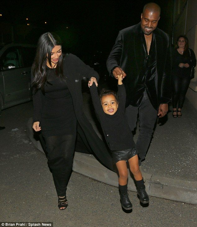 What a lovely sight! Kim Kardashian and her husband Kanye West swing their one-year-old daughter Nori up in the air as they celebrate their last night together in Armenia