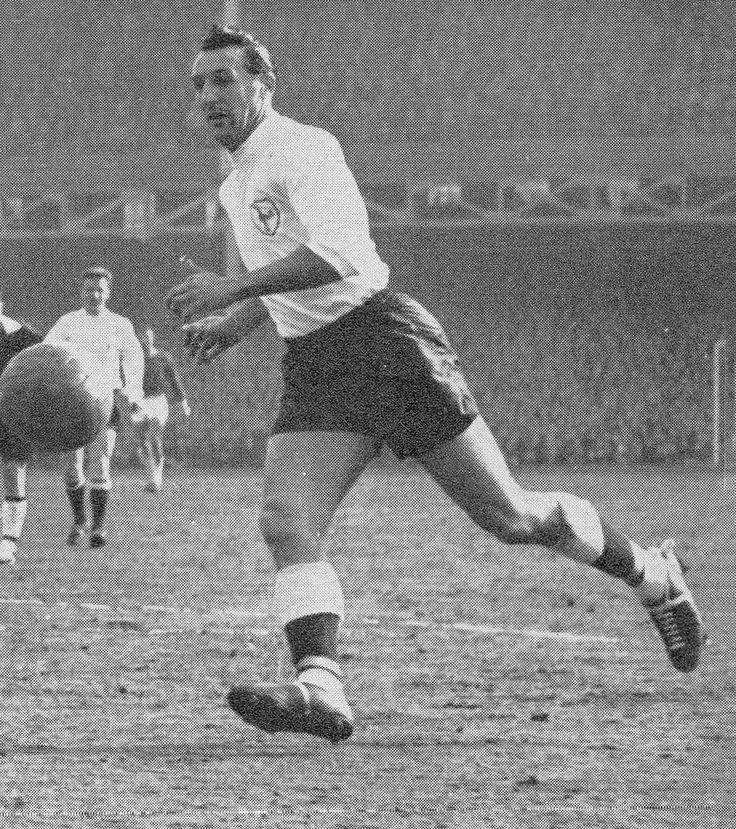 3rd December 1964. Tottenham Hotspur captain Tony Marchi in action against Manchester United, at White Hart Lane.