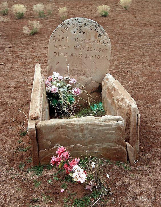 Grave Of A Small Child In An Old Cemetery Near The