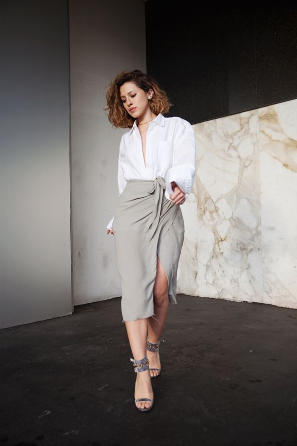 Karla Deras stuns (once again) in a feminine skirt + masculine shirt combo