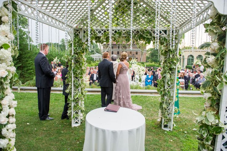One of our beautiful wedding ceremonies in the Tuscan Garden at Celebrate at Snug Harbor. We love the decor (and this bride's absolutely gorgeous dress)!