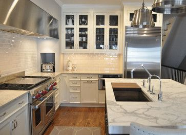 love the large hood --- longer than the range.  Mother of pearl quartzite on the counters, subway tile backsplash, honed marble on island --- love it all