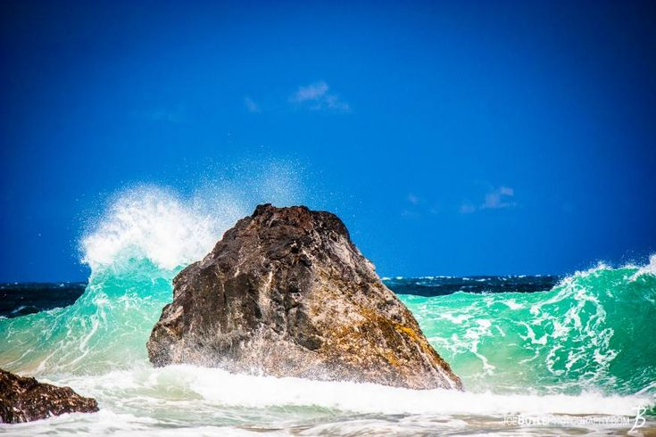 While on a trip to Hawaii I was able to capture this Pacific wave getting ready to crash upon the rock!