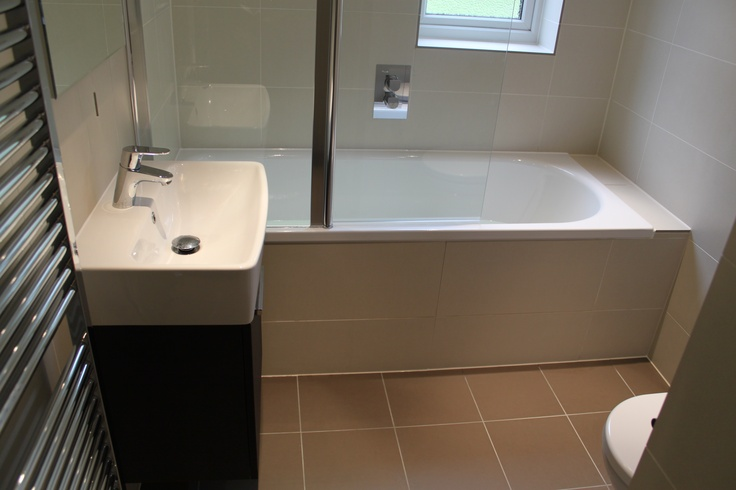 This compact ground floor bathroom was transformed by changing the size of the window which allowed a shower to be placed over the Bette Ocean bath. The Dansani Poco vanity set fits well in the small space and the Gessi Manzoni shower works wonderfully from the combination boiler that supplies the hot water.