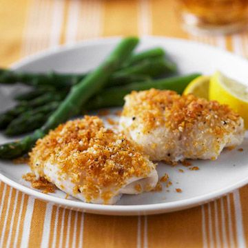 Lemon and Parmesan Fish  4 2oz tilapia   Nonstick cooking spray  1/4c crushed cornflakes  2 tbsp grated Parmesan cheese  2 tsp butter melted  1/2 tsp finely shredded lemon peel  1/8 tsp black pepper Preheat oven 450 In a small bowl, combine crushed cornflakes, Parmesan cheese, melted butter, lemon peel, and pepper. Sprinkle crumb mixture on top of fish roll-ups.  Bake for 6 to 8 minutes or until fish flakes easily when tested with a fork and crumbs are browned.