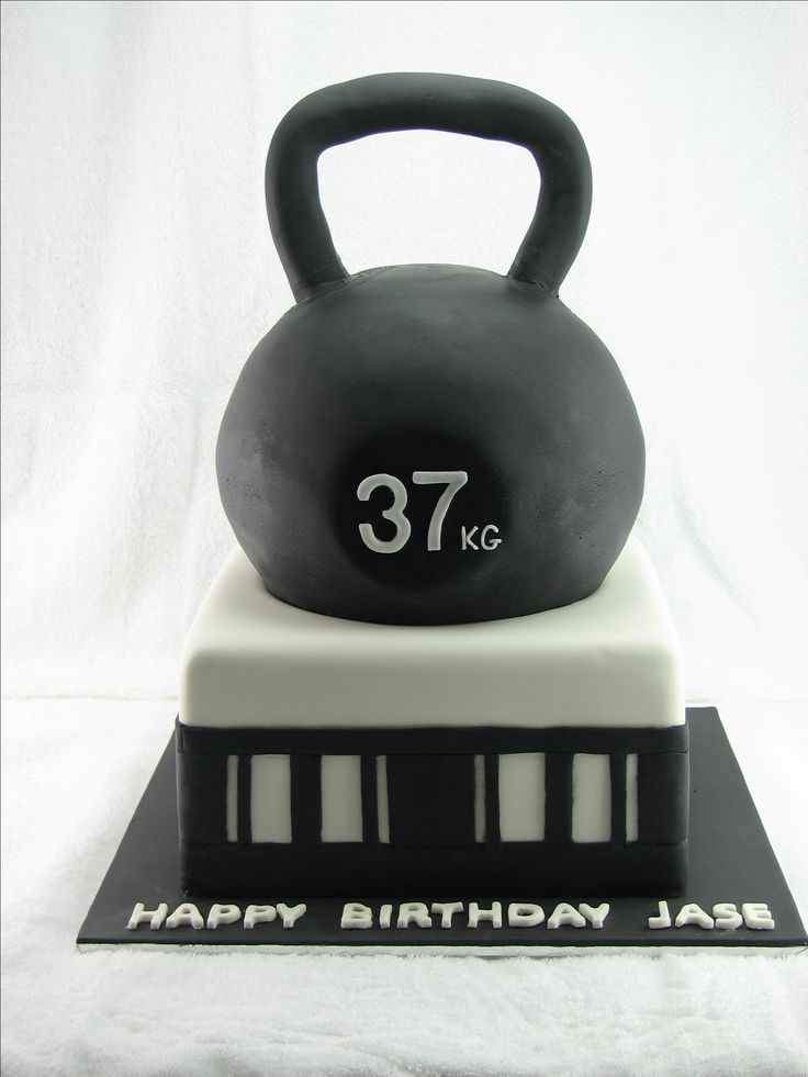 Kettlebell cake: All chocolate mudcake with milk chocolate ganache filling and covered in black and white fondant. www.facebook.com/cakesbyleannerhodes