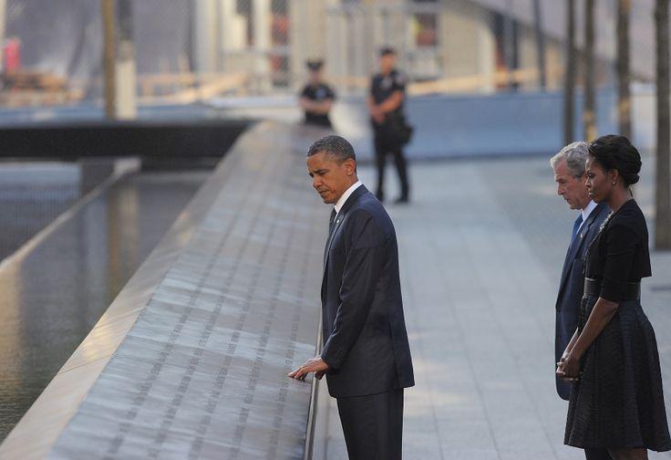 President Barack Obama, former US President George W. Bush and First Lady Michelle Obama