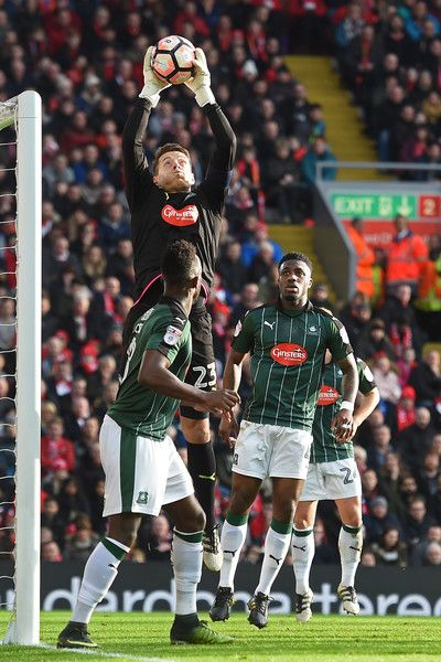 Plymouth's English goalkeeper Luke McCormick catches the ball during the English FA Cup third round football match between Liverpool and Plymouth Argyle at Anfield in Liverpool, north west England on January 8, 2017. / AFP / Paul ELLIS / RESTRICTED TO EDITORIAL USE. No use with unauthorized audio, video, data, fixture lists, club/league logos or 'live' services. Online in-match use limited to 75 images, no video emulation. No use in betting, games or single club/league/player publications…