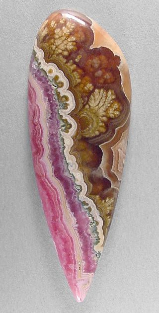 cabochon of rhodochrosite, from Argentina, with PLUMES! At one side, this outstanding stone features wavy bands of glowing pink coloration. And the other side has honey-colored gel (calcite), very gemmy & translucent, which contains several beautifully ornate plumes with ghostly fortifications. Separating the two zones is a scalloped band of cream, with fancy little figures that resemble buds.