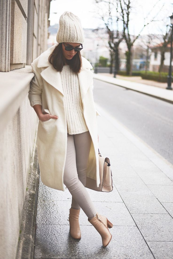 Make a nude coat and grey slim jeans your outfit choice for a comfortable outfit that's also put together nicely. Tan leather booties are a savvy choice to complete the look.  Shop this look for $118:  http://lookastic.com/women/looks/beanie-sunglasses-cable-sweater-coat-skinny-jeans-satchel-bag-ankle-boots/5378  — Beige Beanie  — Black Sunglasses  — Beige Cable Sweater  — Beige Coat  — Grey Skinny Jeans  — Beige Leather Satchel Bag  — Tan Leather Ankle Boots