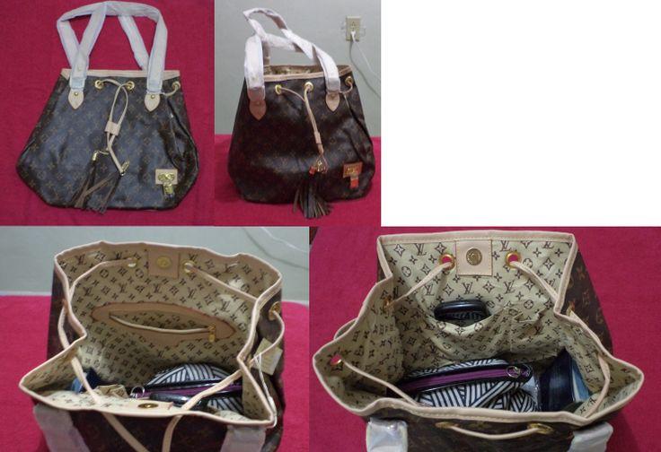 [C-LV-0002]. Cartera color café oscuro y bordes salmón suave; cartera tipo Noé; 1 bolsa interna con zipper; compartimientos para celulares.