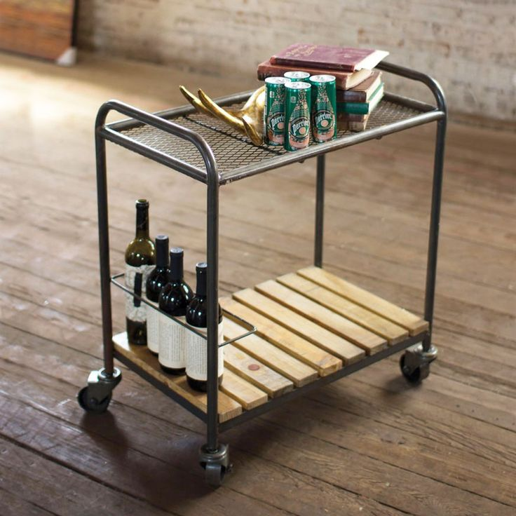 This is a cocktail bar on wheels. Load it up with drinks down below and glassware up top. Add a plate of cheese for extra impact.