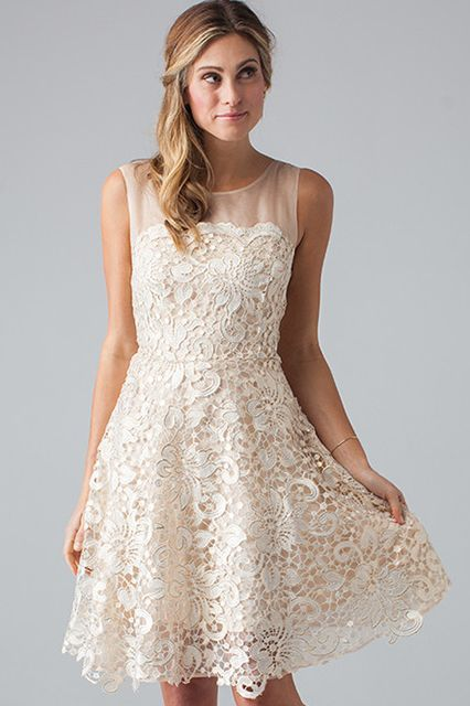 Looking for a little white dress to wear for your City Hall vows? Well, look no further. This sleeveless fit-and-flare number is a delight, from its floral lace detailing to its sheer organza neckline. It's also perfect for your rehearsal dinner, bridal shower, or bachelorette luncheon.