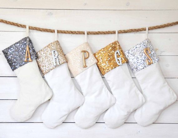 Monogrammed tags with the initials of each member in your household jazz up glitter-flecked stockings. ($190 for five, twentyeight12.etsy.com)