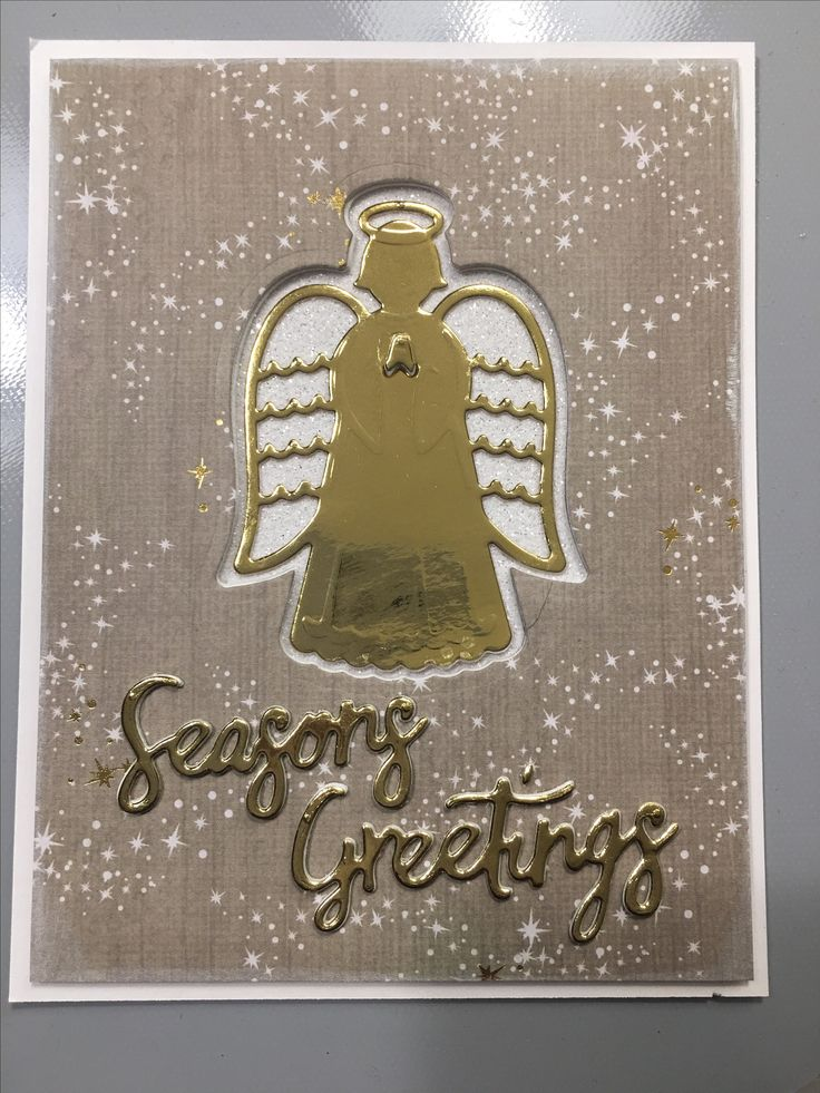 This card uses the new mirror paper and angel die from Tonic Studios.