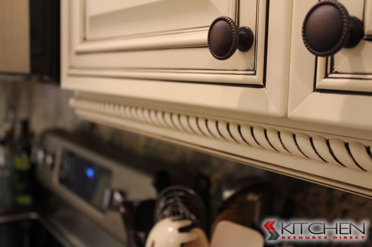 Rope molding with chocolate glaze cabinets.