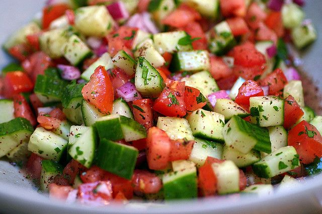 israeli salad-the core recipe is half a red onion, two tomatoes, a one-pound english cuke, lemon juice, olive oil, finely minced parsley, salt, pepper and I throw in a teaspoon or two of sumac powder.