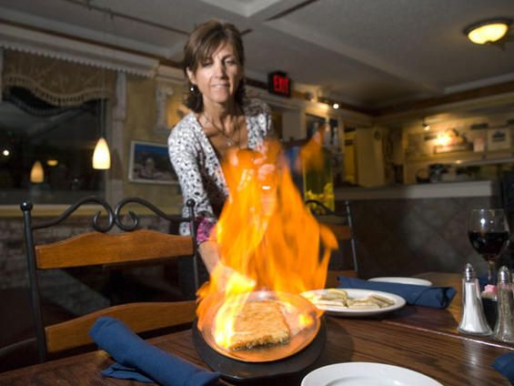 Great cuisine: the Saganaki at the Athenian, one of Denver's best Greek restaurants.