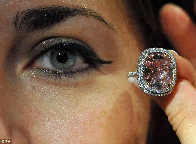 """http://dailym.ai/1O8063I  #Rare '#Fancy #Vivid' 16 #carat #pink #diamond is expected to fetch up to £18 #MILLION when it goes under the #hammer in #Geneva  """"...be careful of pink #eye""""   #diamonds #auction #famous  #Swiss"""