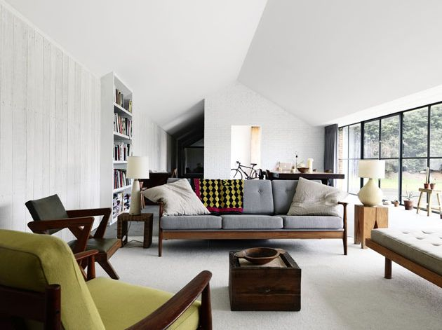 Love the clean lines and the mixture of wooden retro furniture against the backdrop of white contemporary walls.