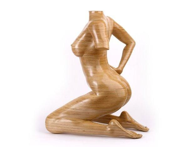 Wooden sculpture cabinet, profile view