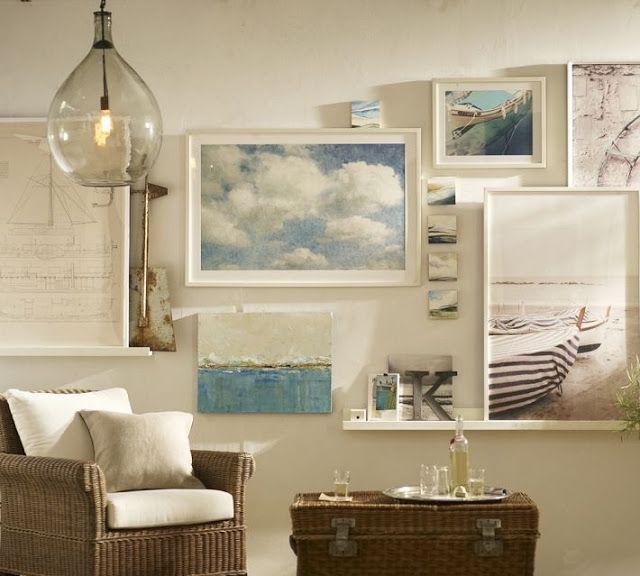 Gallery wall with picture ledges and wall hung art