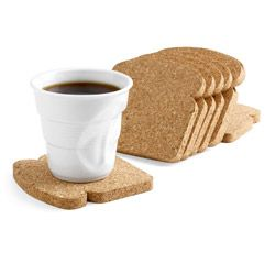 """Toast It Coasters, by Patricia Naves, 2010.  Fun toast-shaped cork comes packaged like a loaf of multigrain bread and is designed to be used as coasters and trivets. Wipe with a damp cloth. Set of eight.""  $10"
