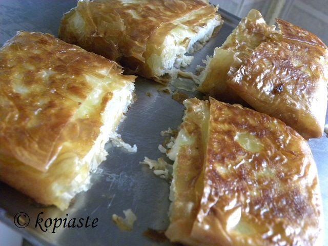 Crispy Phyllo wrapped Feta, a super tasty and super easy cheese appetizer!   Φέτα Σαγανάκι, τυλιγμένη σε Φύλλο, ένα εύκολος και νόστιμος τυρένιος μεζές για την Τυρινή. #appetizer